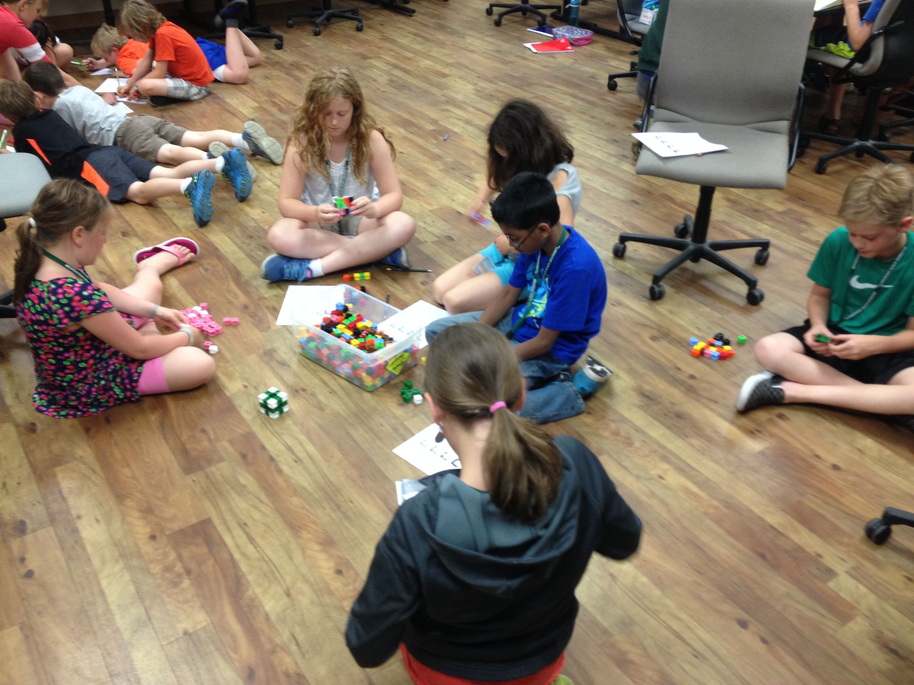 students sitting on the floor putting block pieces together