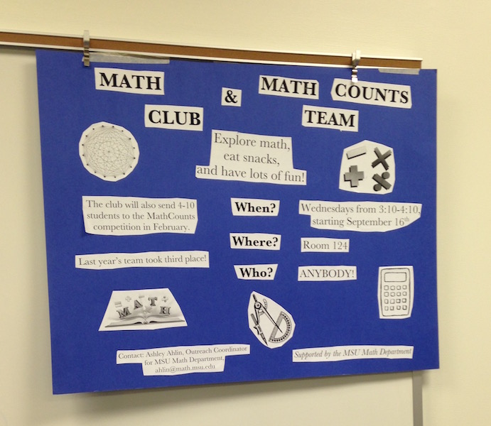 whiteboard with Math Club poster
